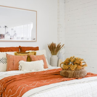 This is an example of a large mediterranean bedroom in Sunshine Coast with white walls.