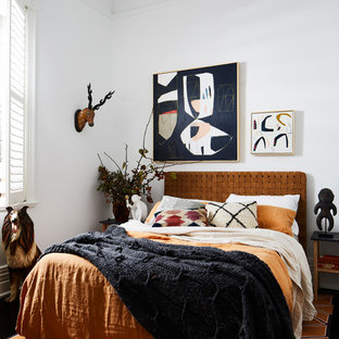 Example of a trendy guest black floor bedroom design in Melbourne with white walls