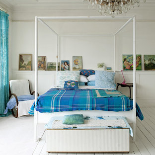 Design ideas for a romantic bedroom in London with white walls and painted wood flooring.