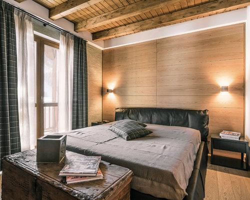 Ispirazione per una camera padronale rustica di medie dimensioni con ...