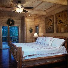 Rustic Bedroom by Satterwhite Log Homes