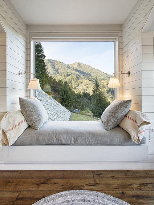 small rustic guest dark wood floor bedroom idea in san francisco with white walls - Rustic Bedroom Design Pictures