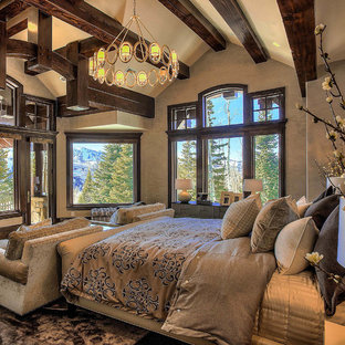 Inspiration for a large craftsman master dark wood floor and gray floor bedroom remodel in Salt Lake City with gray walls, a corner fireplace and a stone fireplace