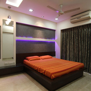 Photo of a mid-sized modern master bedroom in Mumbai with brown walls, marble floors and no fireplace.