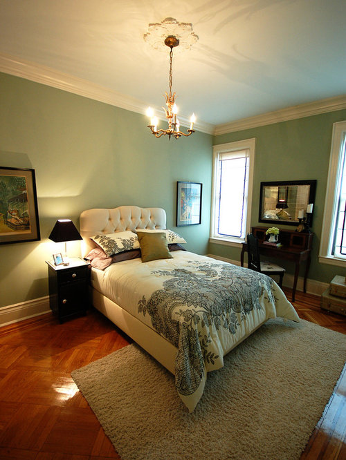 Example Of A Clic Guest Bedroom Design In Other With Green Walls And Dark Wood Floors