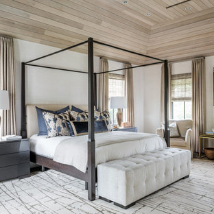 Transitional master dark wood floor bedroom photo in Houston with white walls