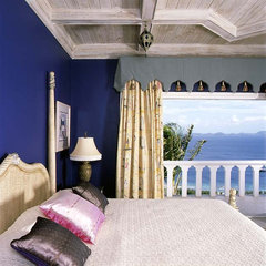 tropical bedroom by Bruce Palmer Interior Design