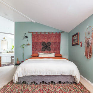 Inspiration for a beach style master beige floor bedroom remodel in Los Angeles with green walls