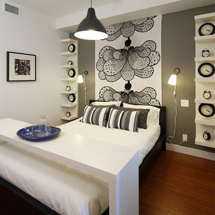 Inspiration For A Contemporary Medium Tone Wood Floor Bedroom Remodel In  Calgary With White Walls