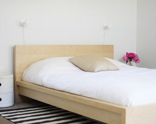 Example of a danish bedroom design in Boise with white walls