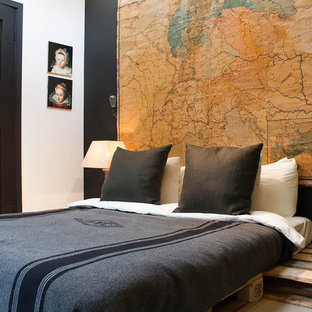 Bedroom - industrial bedroom idea in Amsterdam with black walls