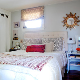 Example of an eclectic bedroom design in New York