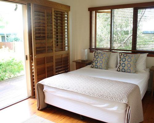 Sliding door plantation shutters home design ideas for Plantation style bedroom