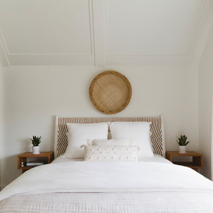 Coastal master bedroom photo in Chicago with white walls