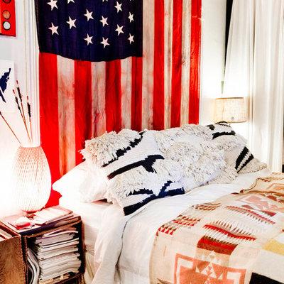 Bedroom - eclectic bedroom idea in New York with multicolored walls