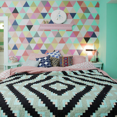Inspiration for an eclectic dark wood floor bedroom remodel in Dallas with multicolored walls