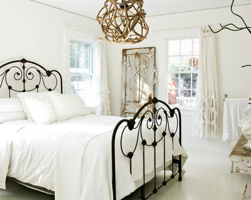 Cottage chic white floor bedroom photo in Tampa with white walls