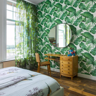 This is an example of an eclectic bedroom in Other with green walls, dark hardwood floors and brown floor.