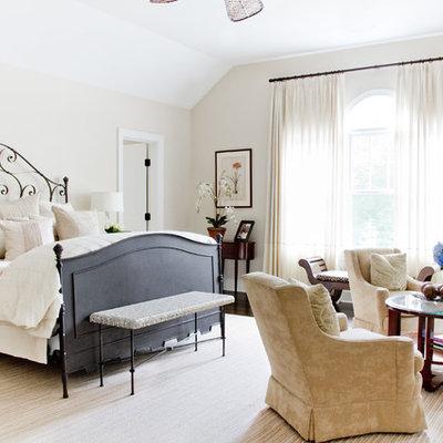 Bedroom - traditional master dark wood floor bedroom idea in New York with beige walls and no fireplace