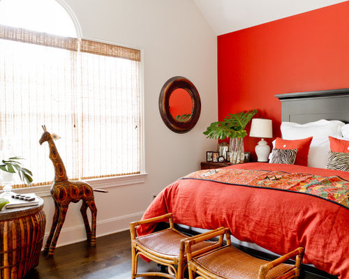 Ex&le of a classic bedroom design in New York with red walls : stool at end of bed - islam-shia.org