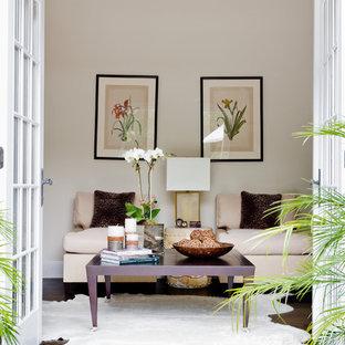 Elegant dark wood floor bedroom photo in New York with beige walls