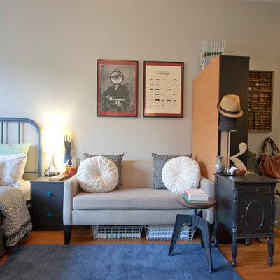 Bedroom - eclectic master medium tone wood floor bedroom idea in New York