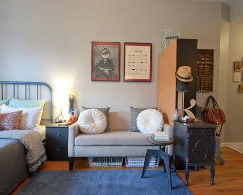 Contemporary Master Medium Tone Wood Floor Bedroom Idea In New York
