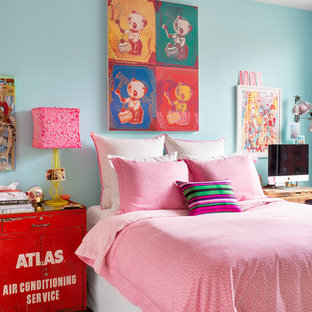 Example of an eclectic bedroom design in New York with blue walls