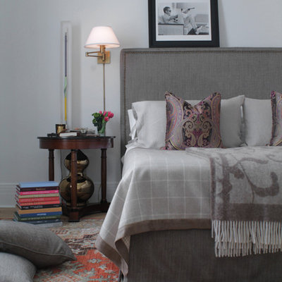 Inspiration for a contemporary master bedroom remodel in Montreal with white walls