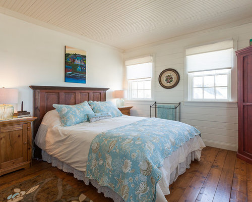 Example Of A Coastal Bedroom Design In Other With White Walls