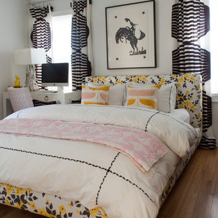 Trendy medium tone wood floor bedroom photo in Dallas with white walls and no fireplace