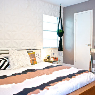 Trendy medium tone wood floor bedroom photo in Dallas with gray walls and no fireplace