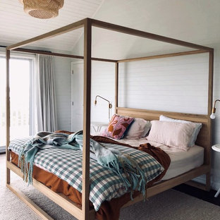 Contemporary bedroom in Perth with white walls and beige floor.