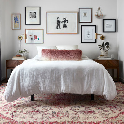 Example of an eclectic dark wood floor bedroom design in Dallas with white walls and no fireplace