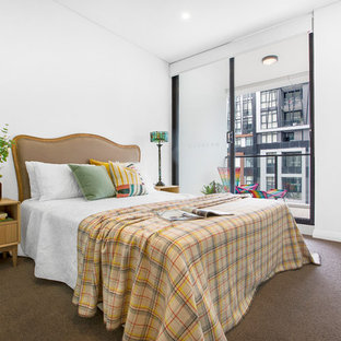 Photo of a modern bedroom in Sydney with white walls, carpet and grey floor.