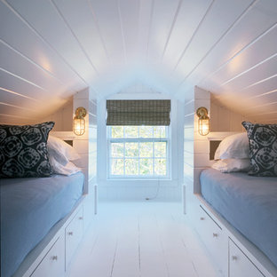Inspiration for a small coastal guest painted wood floor bedroom remodel in Los Angeles with white walls and no fireplace