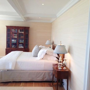 Inspiration for a timeless master light wood floor bedroom remodel in Boston with beige walls