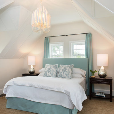 Example of a mid-sized beach style guest bedroom design in Boston with beige walls