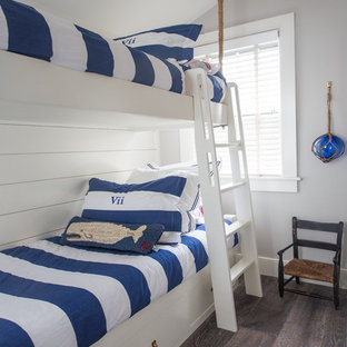 Design ideas for a small beach style guest bedroom in Boston with grey walls, dark hardwood floors and no fireplace.