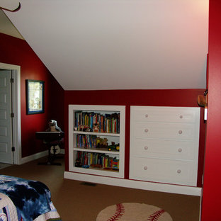 This is an example of a small arts and crafts loft-style bedroom in Other with red walls and carpet.