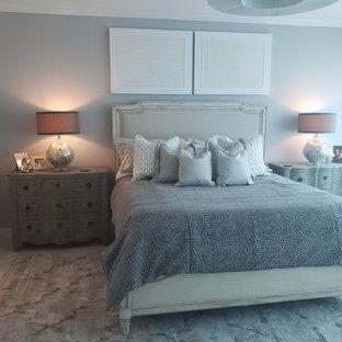 На фото: большая хозяйская спальня в стиле современная классика с серыми стенами, мраморным полом и оранжевым полом без камина с