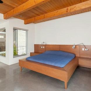 Diseño de dormitorio contemporáneo con suelo de cemento y suelo gris