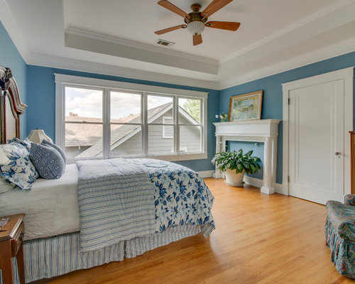 Example of a classic medium tone wood floor and brown floor bedroom design  in Chicago with