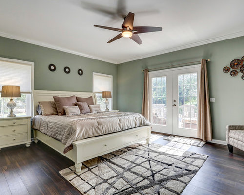 example of a classic master dark wood floor and brown floor bedroom design in other with
