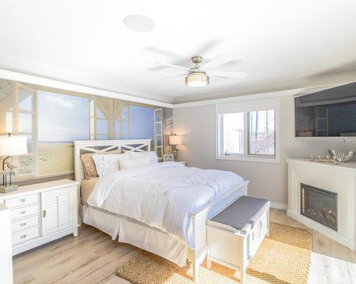 Camera da letto al mare con camino ad angolo foto e idee per arredare - Camera da letto con camino ...