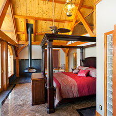 Rustic Bedroom by Texas Timber Frames