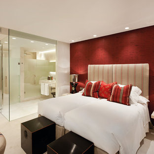 Design ideas for a contemporary master bedroom in London with red walls and beige floors.