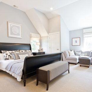 This is an example of a medium sized traditional master bedroom in Boston with grey walls, no fireplace and carpet.