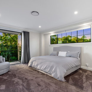 Inspiration for a large timeless master carpeted and red floor bedroom remodel in Brisbane with white walls