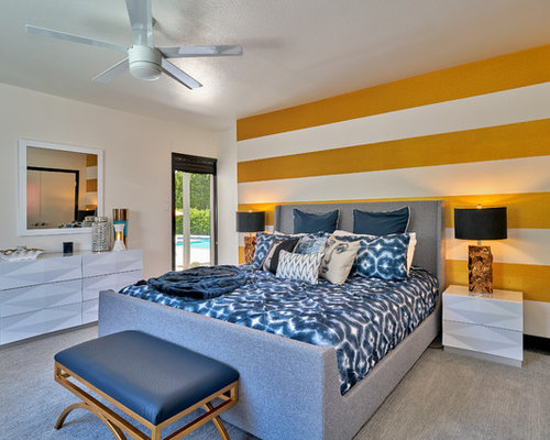 Example Of A Mid Sized 1960s Bedroom Design In Other With Multicolored  Walls, Carpet
